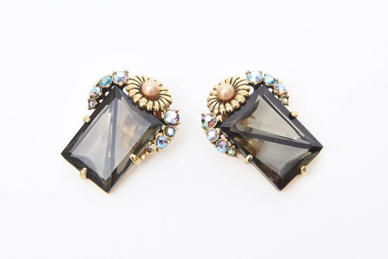 The combination of faceted smoky topaz crystal glass with turquoise boris aurealis glass stones and clear rhinestones set of with a flower top in gilt metal make these signed vintage Elsa Schiaparelli clip on earrings so elegant. They hug the ear
