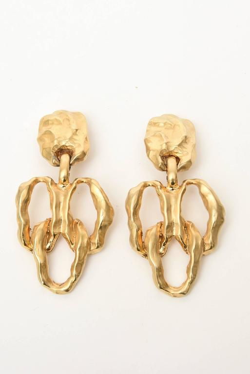 These handsome gold-plated Dangle earrings make a statement. They are clip on's and have some texture to them.