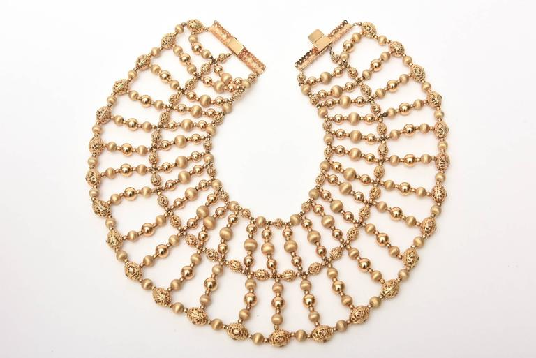 This monumental and arresting Cleopatra style show stopper beaded vintage Napier signed collar necklace is like wearing a piece of fashion and clothing in jewelry form.  It takes up a great space of chest/ collar and spans to the width of your