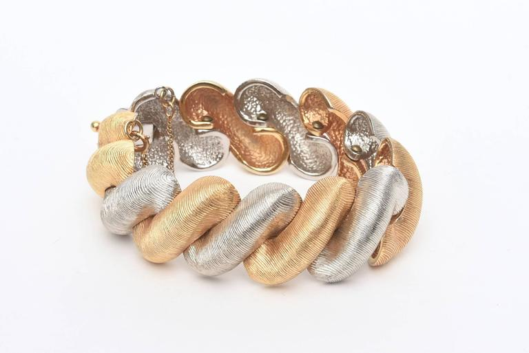 This stunning period bracelet looks authentic and real by Castlecliff.  It is finely lined with a brushed satin finish on the metals. Has a modern elegance to it. Gold plated and silver metal, but looks like real gold and sterling silver. This is