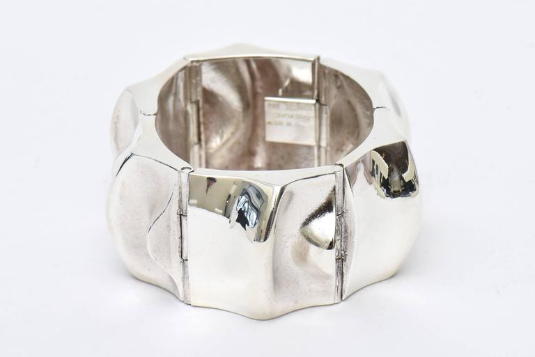 This all hallmarked Scandinavian modern sculptural thick sterling silver signed cuff bracelet has the markings of Sorokoro MJH 925 Made in Fin.It is fabulous! Very modern and chic! It has presence and weight. Tres chic! It is from the 60's. Made in