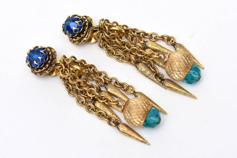 These beautiful long dangle pair of vintage clip on earrings are comprised of turquoise and royal blue faceted crystal stones and chain with dangler on the tips. They look so modern today yet they are from the 60's. Tres Chic and au courant! They