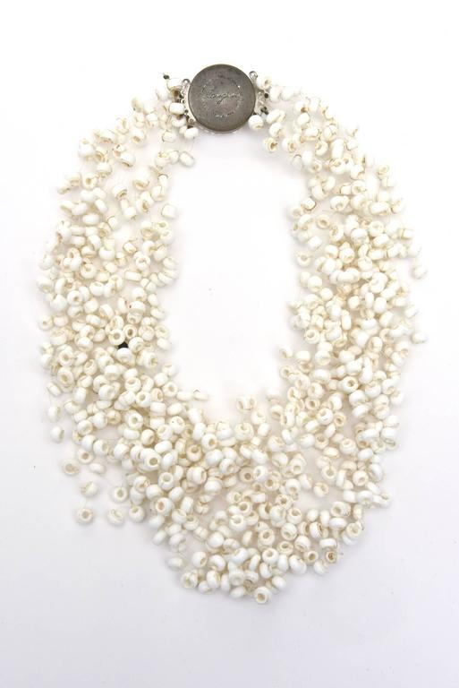 This wonderful and collectable vintage multi strand signed Langani necklace designed by Anna Lang of Germany has a clean, airy and great sculptural presence. Almost as if it is floating on the neck. It is perfect now for spring and summer or for all