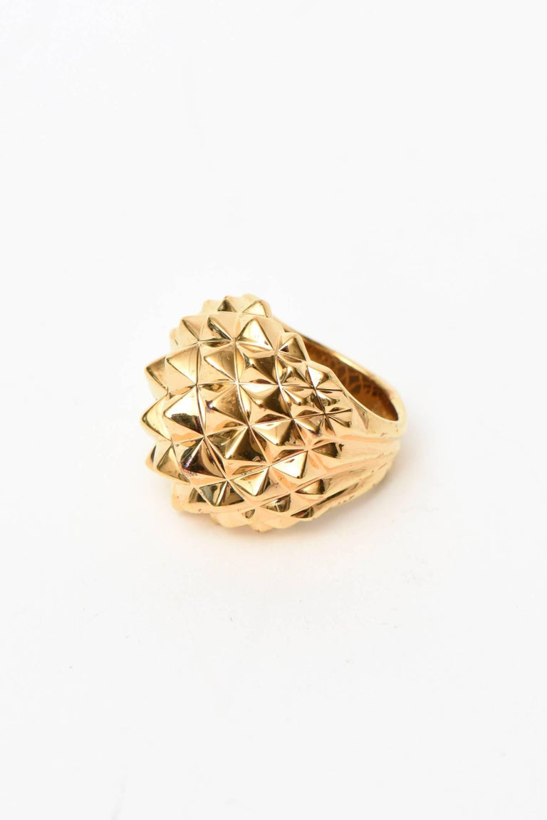 This chic and timeless edgy yet modern 18 K gold plated over sterling silver stud cocktail/dome ring is by none other than the collectable and forward jewelry designer from London named Stephen Webster.  His coterie of clients include famous people