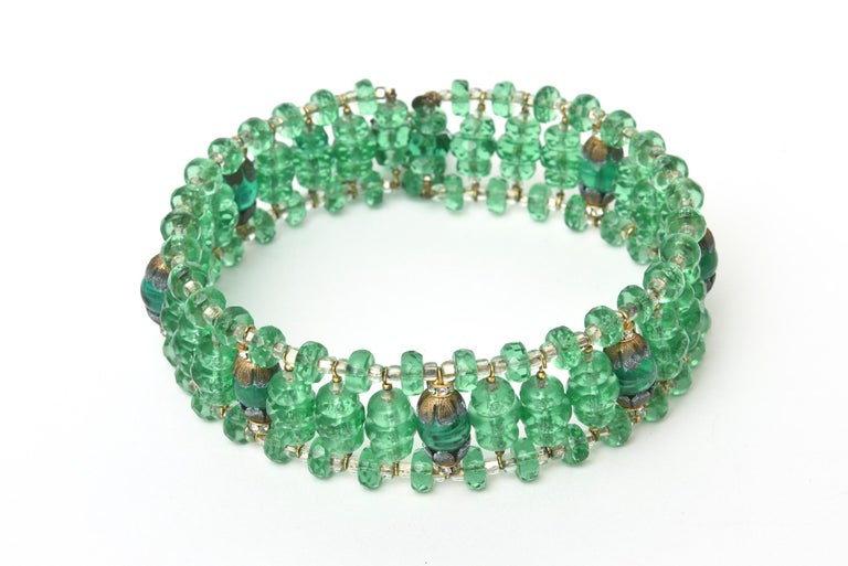 This stunning and amazing set of 2 signed Miriam Haskell mid century modern green glass beaded choler necklace and matching cluster dangle earrings is a gorgeous shade of rich emerald green jewel tone. They can be worn together or separately. Both
