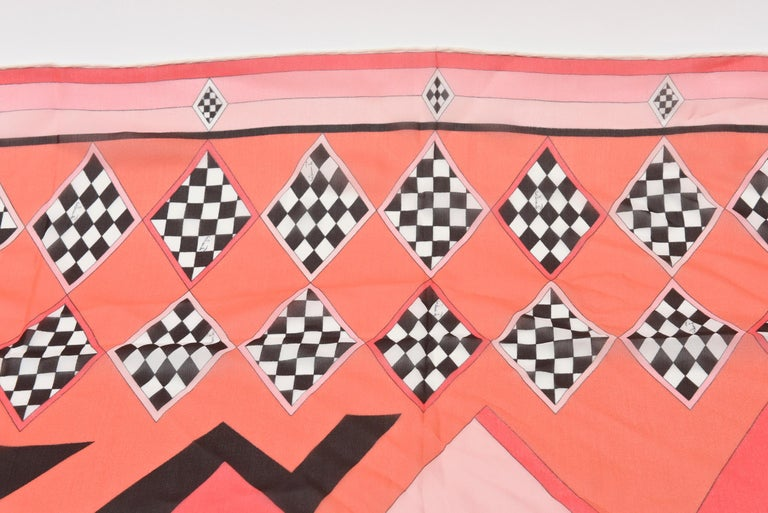 This fabulous 1960's Italian vintage Emilio Pucci silk chiffon scarf has beautiful colors and checkerboard black and white diamond patterns with luscious colors of pink and coral. It has all the original vintage 4 labels on the side of the scarf.