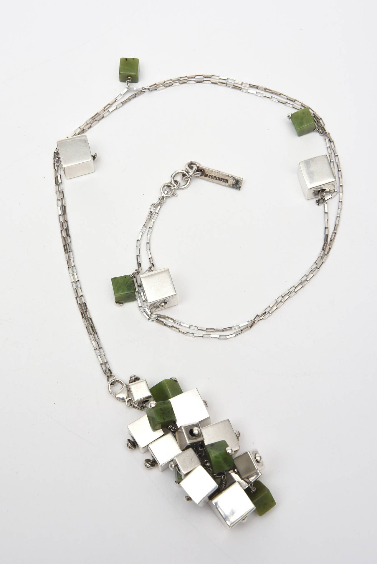 This amazing and spectacular studio necklace is signed, Espinosa, and it has geometric sterling silver boxes w/ jade boxes as well. Signed: Espinosa, Sterling 925. It is extremely sculptural and of cluster formations.  It is most likely one of a