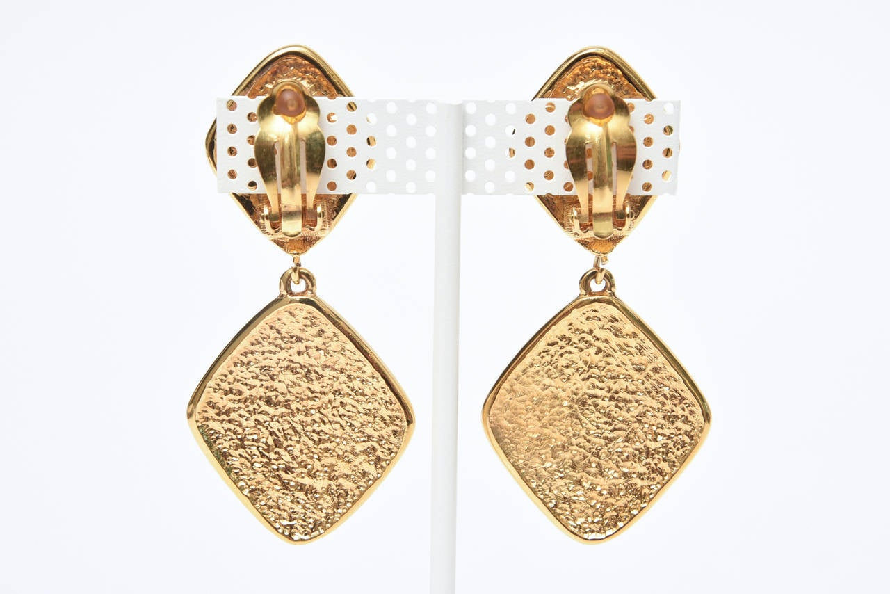 These lovely pair of timeless gold tone criss cross 2 part Chanel signed gold plate on gold plate earrings has a quilted effect. They are marked on the back