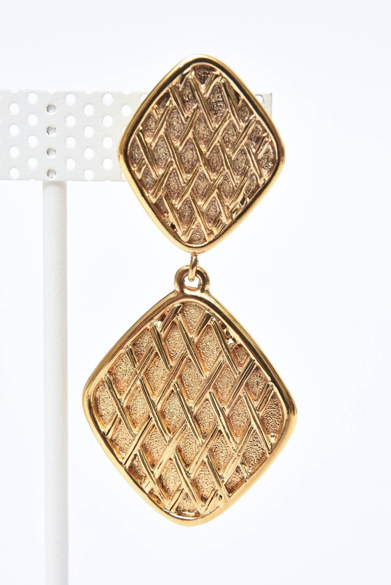 Modern Chanel Pair of Marked Double Criss Cross Hanging Clip On Earrings For Sale