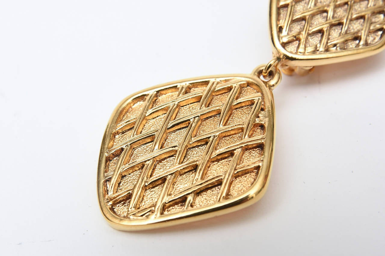 Women's Chanel Pair of Marked Double Criss Cross Hanging Clip On Earrings For Sale