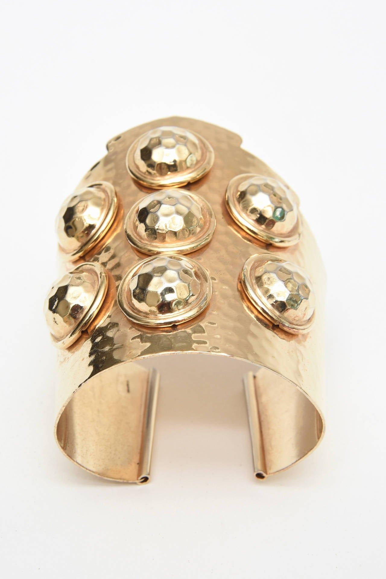 This arresting hand hammered wide and sculptural brass cuff 