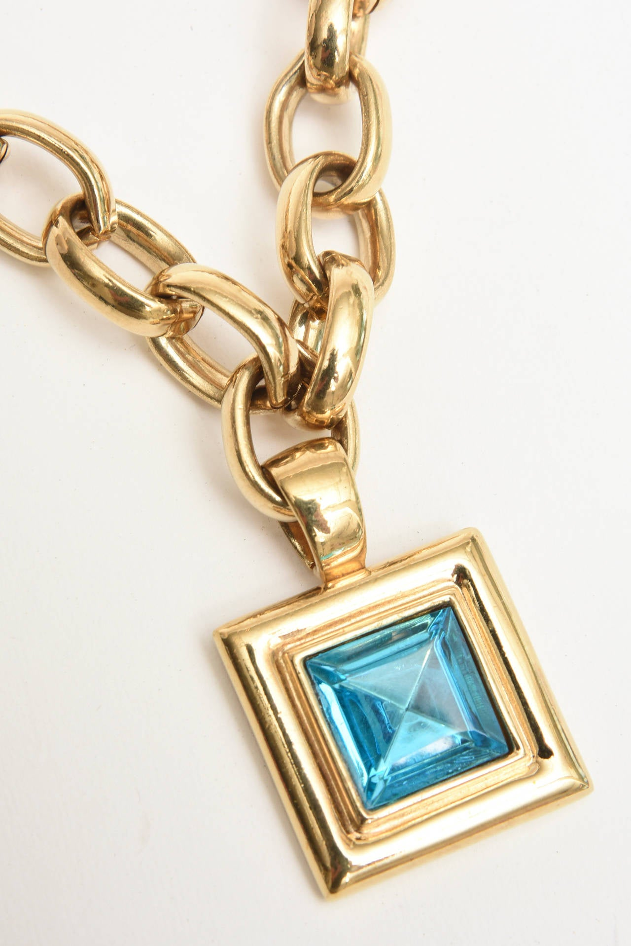 This substantial and heavy brass and glass gold link french signed