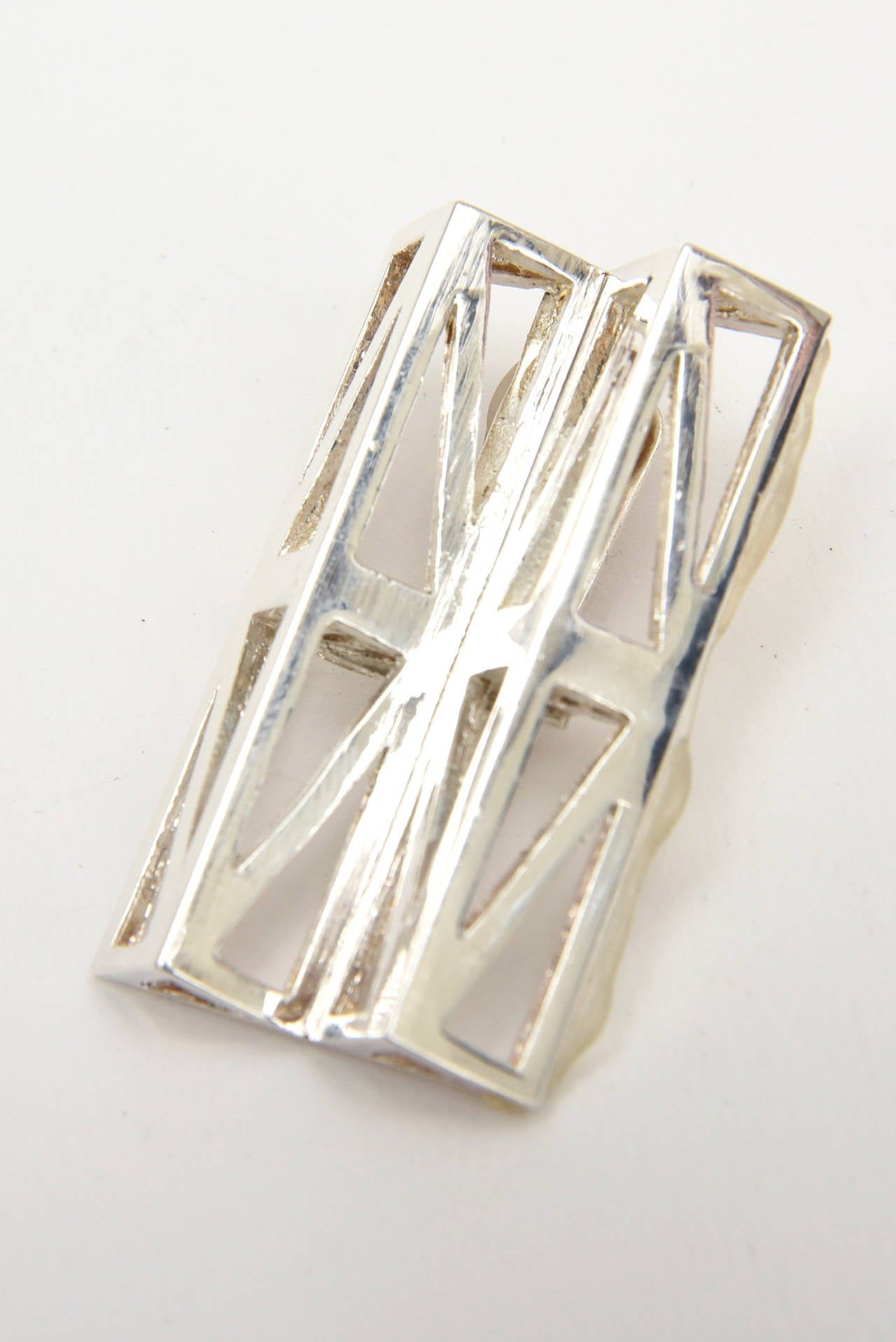 These oh so modernist geometric runway signed silver-plate clip on earrings were runway. They are sculptural and au courant. They are marked; Claude Montana Pour Marie Paris. They were fabulous then, now even more fabulous. They are quite eye