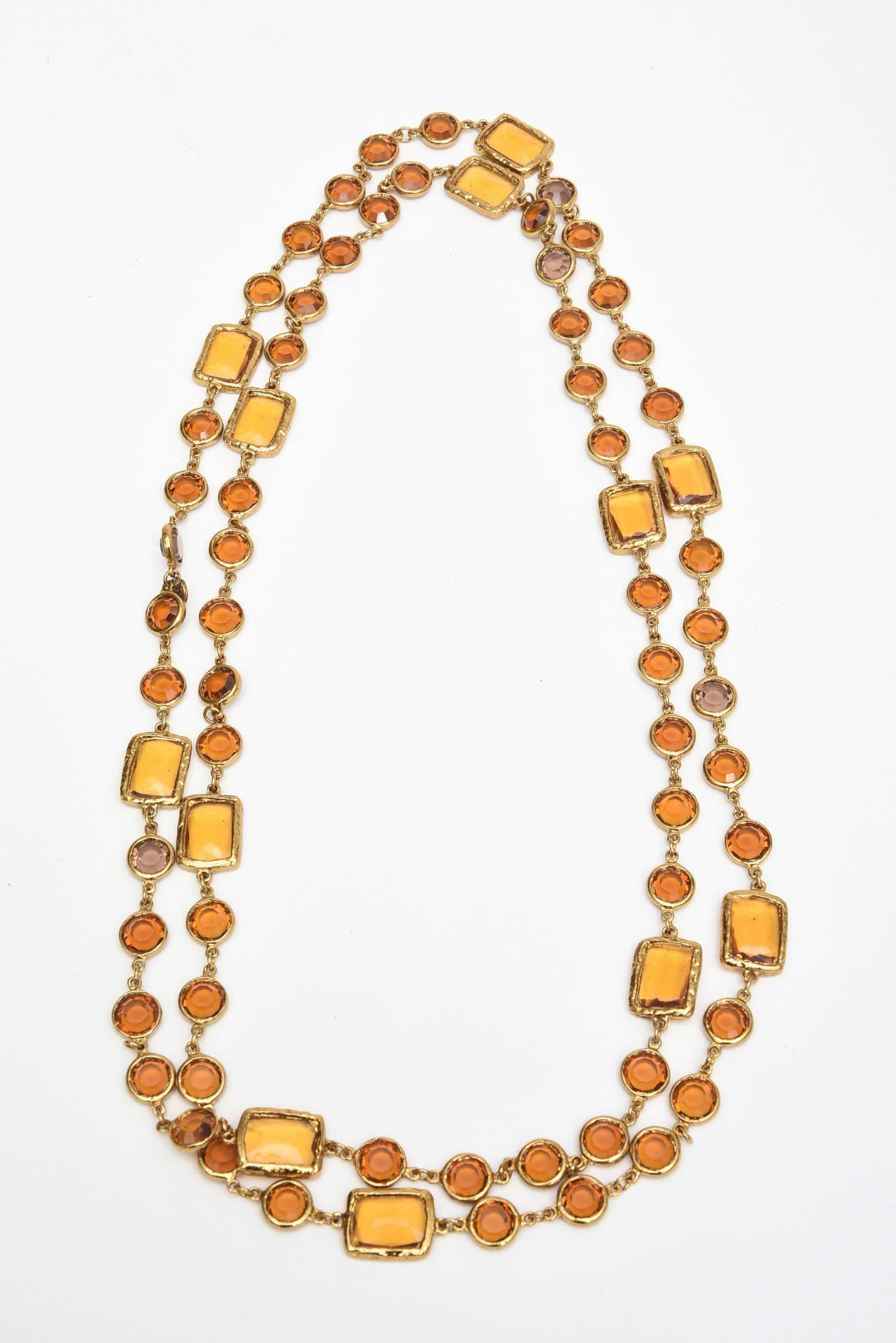 Dark rich amber glass and molted brass are the components to this signed  Chanel chicklet necklace.