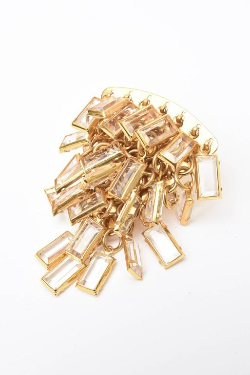 These wonderful and dramatic Italian vintage cascading pair of clip on earrings are composed of tiered small glass chips surrounded by brass. These are perfect for the cocktail hour and evening attire. Very eye catching on the ear and they make a