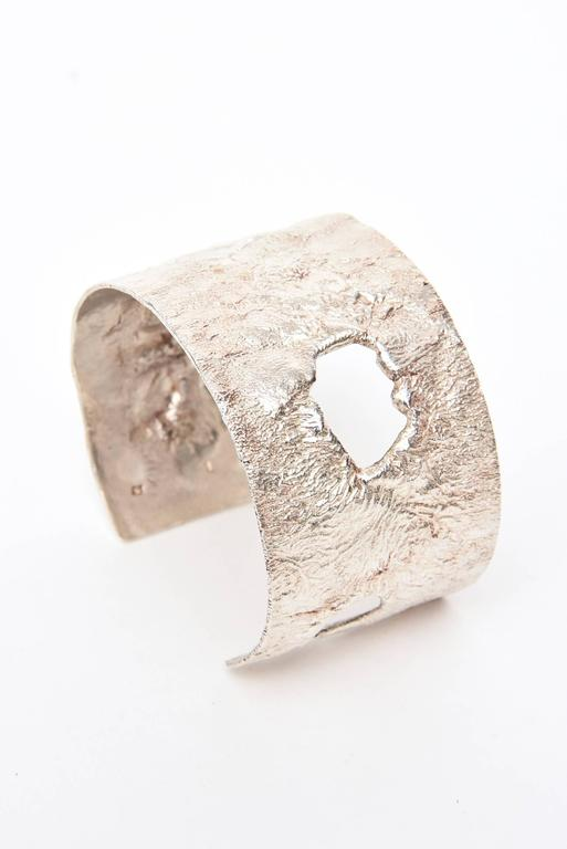 This artisan, most likely Italian signed sterling silver Bracelet,, has 3-cut outs and the sterling silver looks to be of a molten form.  it is signed 925 L Ponte. it is sculptural and artful and oh so rich looking. Looks beautiful on the wrist.