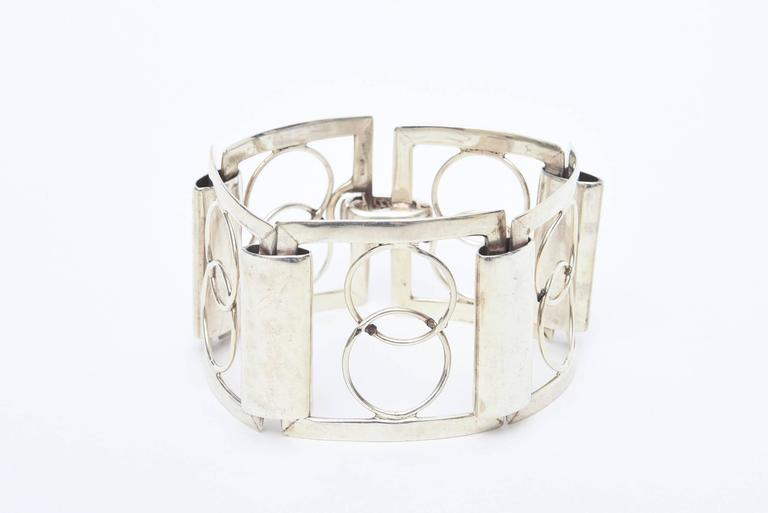 This gorgeous and modern and oh so chic geometric sterling silver Italian cuff bracelet is signed P.R.X. 925 Italy. This was a workshop of artisans that have vanished. It is a forever bracelet with great modernist designs.