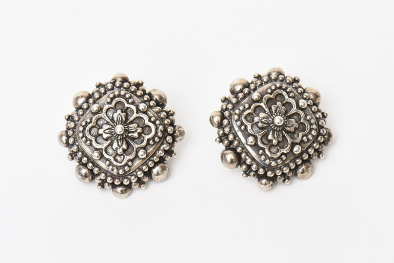 This lovely, signed and early Stephen Dweck sterling silver earrings have some great weight. They have a revival renaissance meets baroque design meets byzantine. They are stamped Stephen Dweck 1991 @ Stephen Dweck