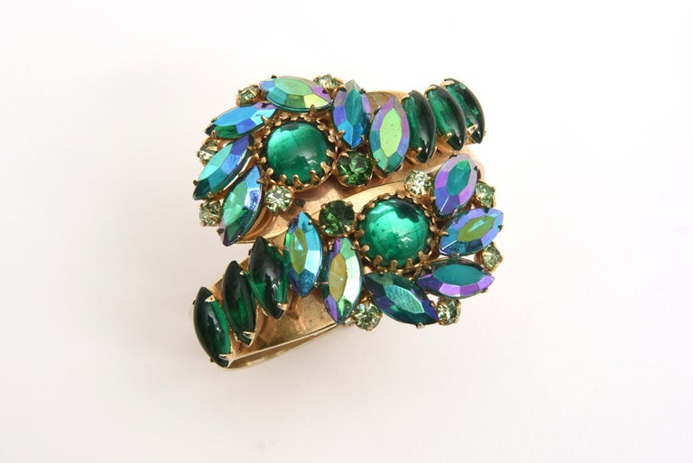 Stunning colors of greens and turquoise of the Aurora Borealis crystals make up this this Alice Caviness mid century modern vintage gorgeous twisted clamp bracelet. It is like the brilliant colors of the sea exaggerated in luminosity and brilliance