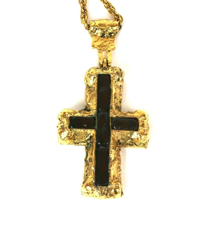Chanel Byzantine Cruciform  pendant of rough Martelé gilt bronze with five large hand made garnet-ruby pate de verre baguettes. Handmade by Robert Goossens for Chanel.  According to family tradition this crucifix necklace was a personal gift of