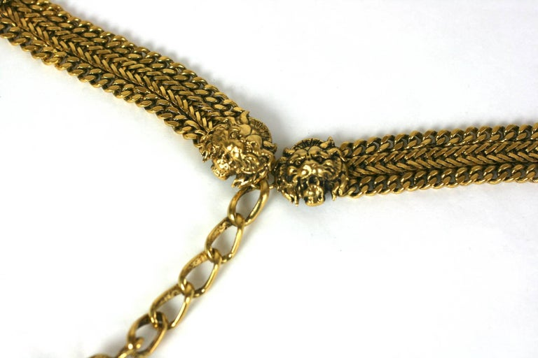 CoCo Chanel early chain belt composed of signature curb chain with classic signature lions head motifs terminating in an adjustable pendant tassel.  Coco Chanel synthesizes her favorite lion motif,  one of the codes deeply rooted to the House of