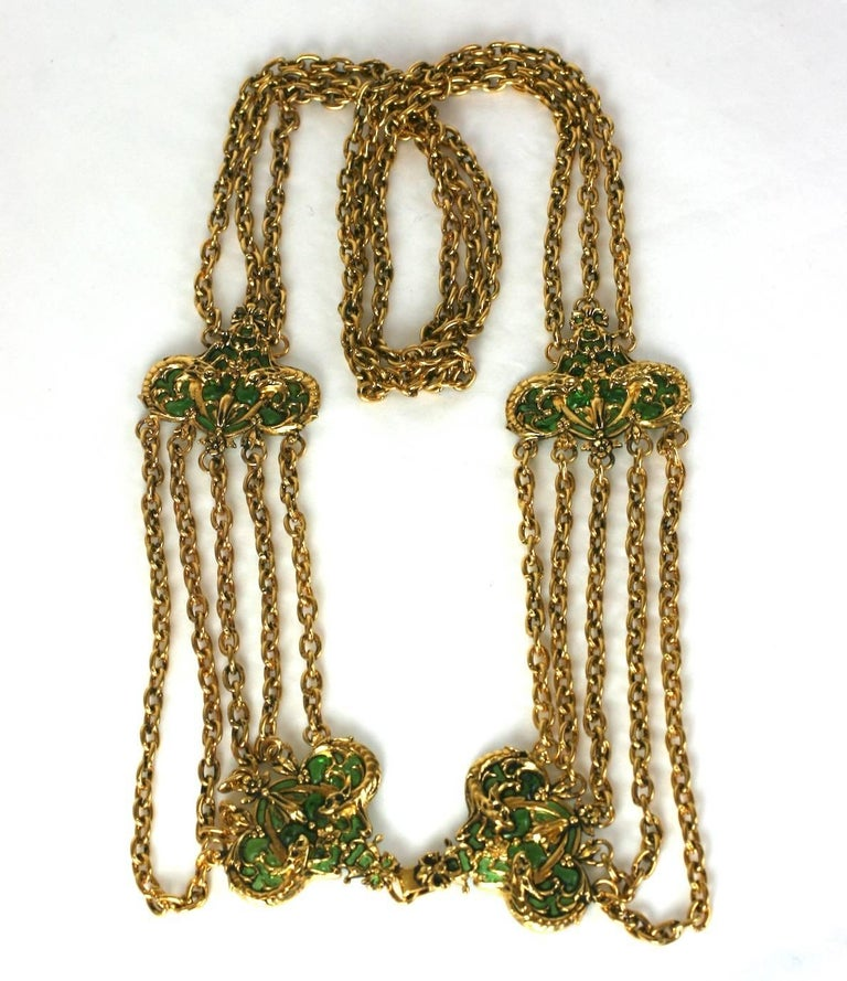 Coco Chanel Early Poured Glass Haute Couture Belt. Designed as a series of swag chains with emerald poured glass stations. Classically Baroque in the Chanel idiom with sea serpent motifs highlghted by the emerald poured glass settings. Maison R.
