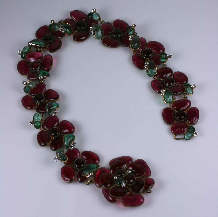 CoCo Chanel massive deep ruby, emerald pate de verre and crystal flower belt. One of CoCo Chanels self re inventions, refering back to her signature Fleur Emaille flower necklaces and brooches of the late 1930s. Made by Maison Gripoix in CoCo