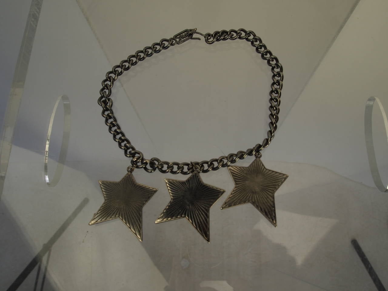 Yves Saint Laurent chain necklace with green, red and yellow enameled stars and hook closure.