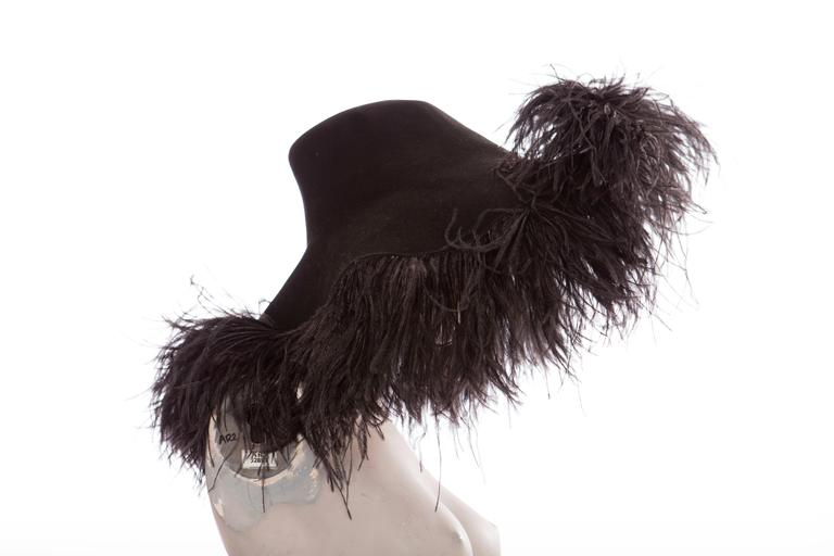 Alber Elbaz for Lanvin, Fall 2004 runway black wool felt hat with ostrich feather trim.  Circumference: 40, Brim 4