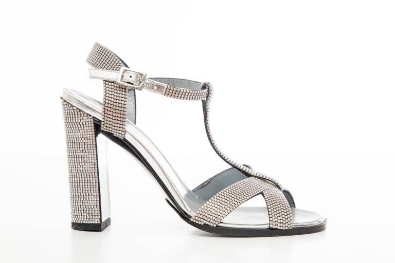 Tom Ford for Gucci, Spring-Summer 2000 metallic silver leather T-strap sandals with strass crystal embellishments throughout, covered heels and buckle closure at ankle straps.   Heels: 4.25