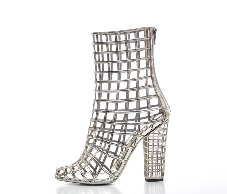 Yves Saint Laurent, Stefano Pilati Spring 2009 silver metallic leather peep-toe caged ankle boots with zip closures at backs and block heels. Includes box and dust bag.  IT. 40, US. 10   Calf Circumference: 11, Shaft 7, Heels 5