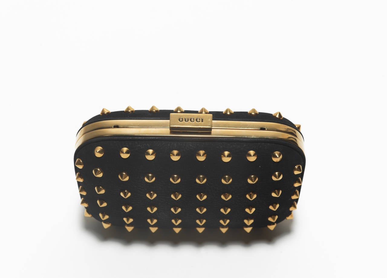 """Gucci, black nubuck leather clutch with allover gold studs, drop-in strap, leather lining and top push-lock closure. Includes box and dust bag.    Shoulder Strap Drop 7.5"""", Height 4"""", Width 6"""", Depth 1.5"""""""
