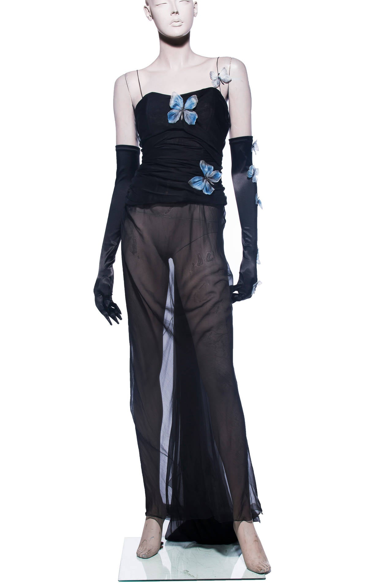Dolce & Gabbana, Stromboli Collection Spring-Summer 1998, black silk chiffon dress with blue butterfly applique, corset top and back hook closure with matching satin gloves.