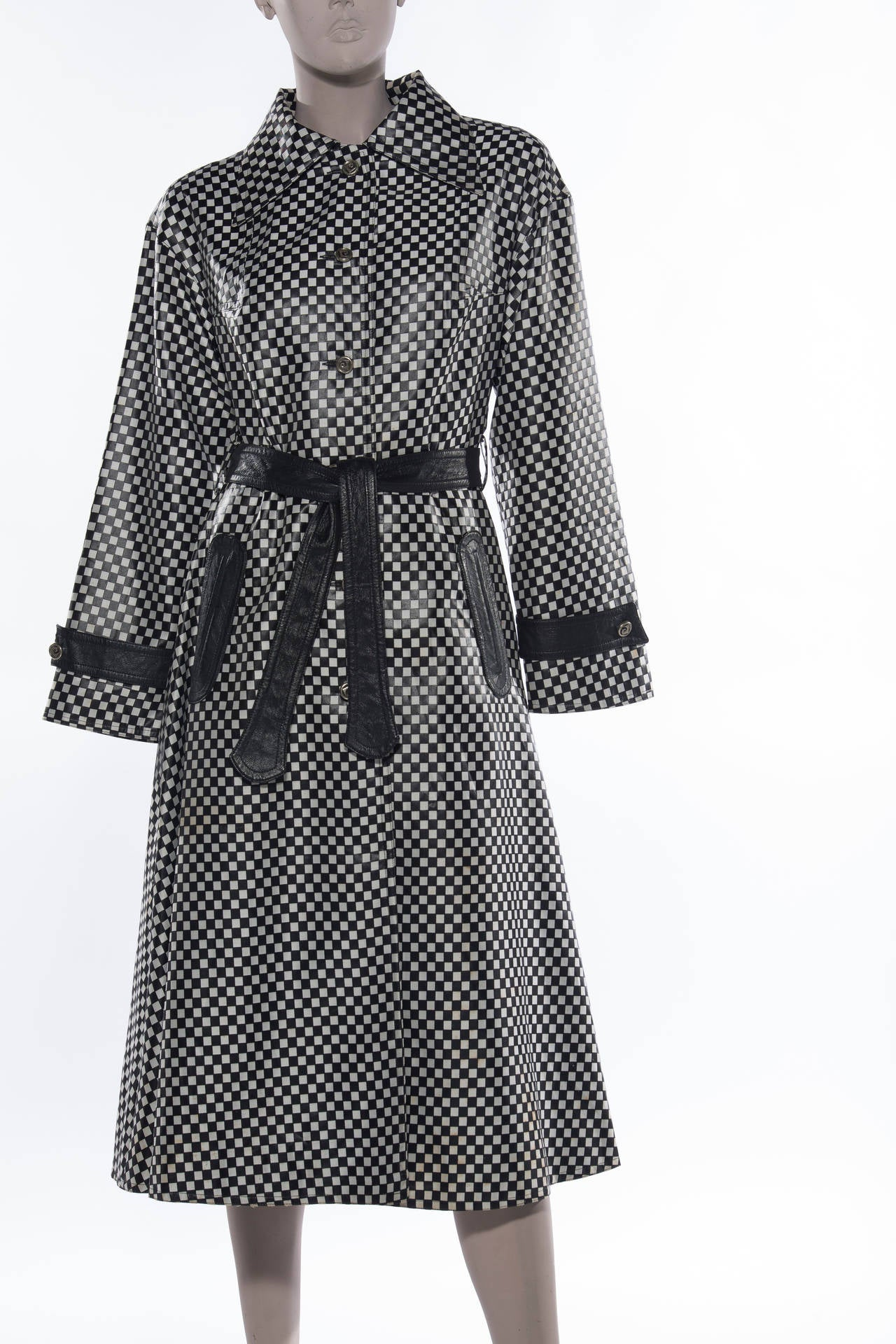 Pierre Cardin, circa1960s black/white check, belted, rain coat, two front pockets and fully lined.