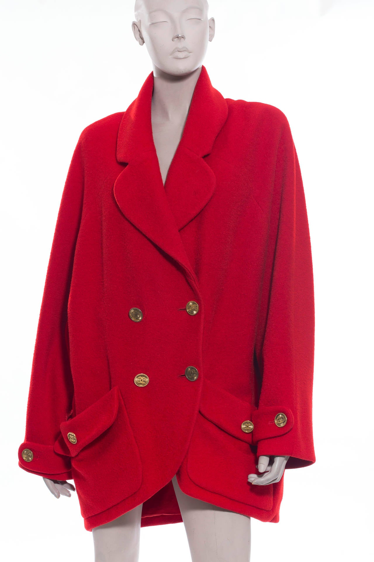 Chanel, Circa 1980's, red double breasted cocoon wool coat with signature CC buttons, two front pockets and fully lined in silk.