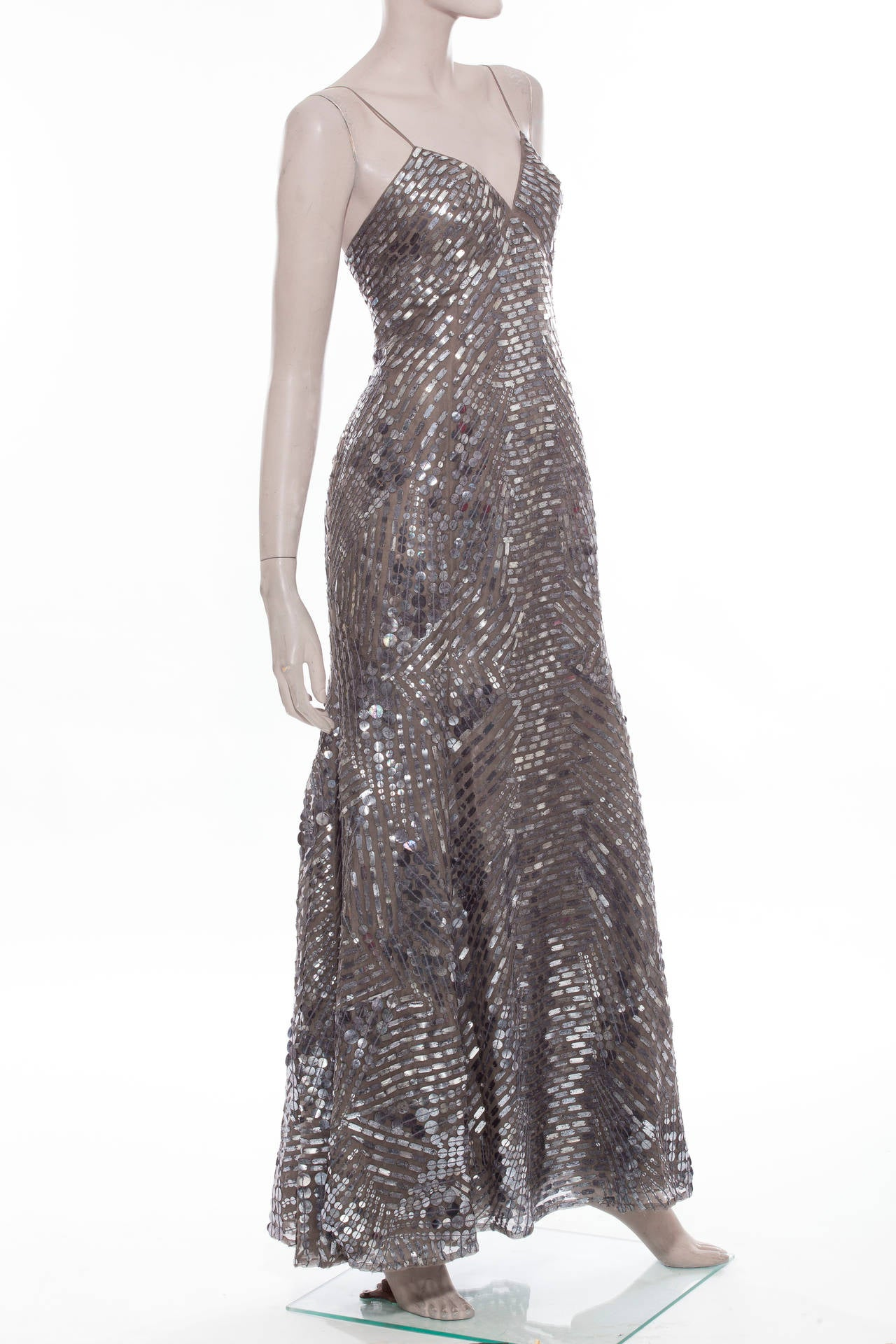 Oscar de la Renta, Autumn-Winter 2007 sleeveless silk evening dress with pewter embellishment throughout, V-neckline, invisible back zip closure and fully lined in silk.