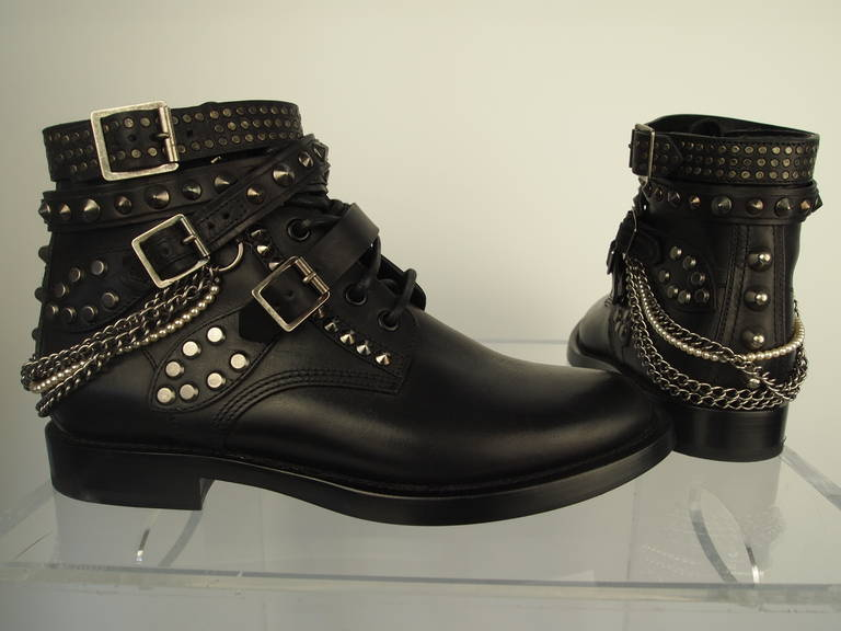 Saint Laurent Ranger Boots, black studded leather, metal and faux pearl chains, adjustable straps, leather lining and soles.