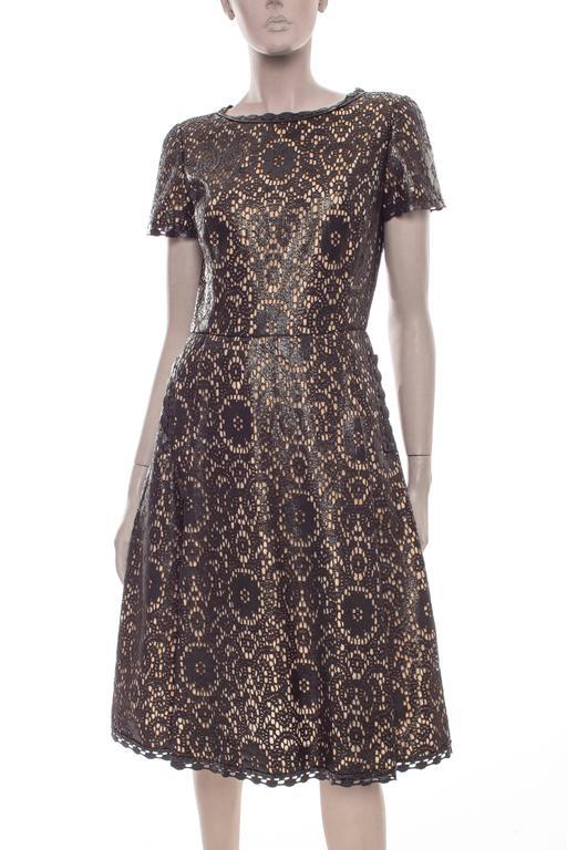 Oscar De la Renta, Fall 2006, black laser cut, short sleeve princess dress, two front pockets,back zip and fully lined.