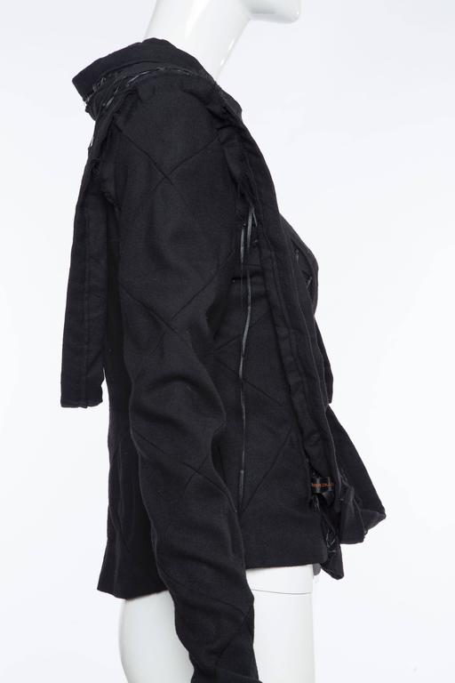 """Undercover, Fall circa 2006, top with built-in gloves, lace-up insets throughout, wraparound sash and back zip closure.  Bust 36"""", Waist 30"""", Length 22"""" Fabric Content: 100% Wool; Fabric 2: 100% Polyester"""