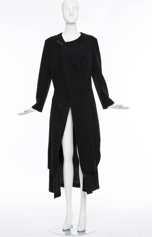 """Comme des Garçons, circa 1997 black wool coat with asymmetrical neckline, long sleeves, tonal stitching throughout and safety pin closure at front.  Bust 38"""", Waist 33"""", Shoulder 17.5"""", Length 45.5"""", Sleeve 28.5"""""""