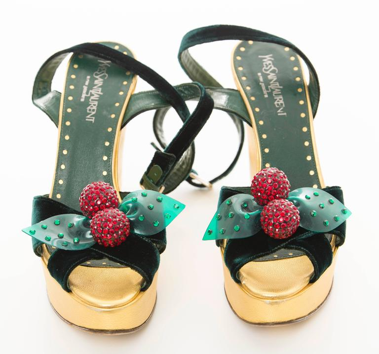 Tom Ford for Yves Saint Laurent, Autumn-Winter 2003, gold leather and green velvet platforms with removable cherry shoe clips.