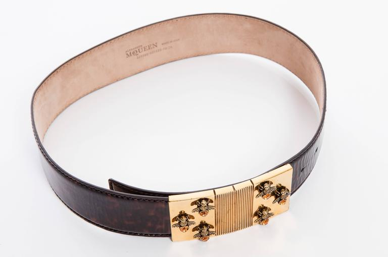 """Alexander McQueen by Sarah Burton, Spring 2013 patent leather tortoise belt with tonal stitching and gold-tone bee buckle featuring peg-in-hole closure. Includes dust bag  Length 26""""-30.5"""", Width 2"""""""