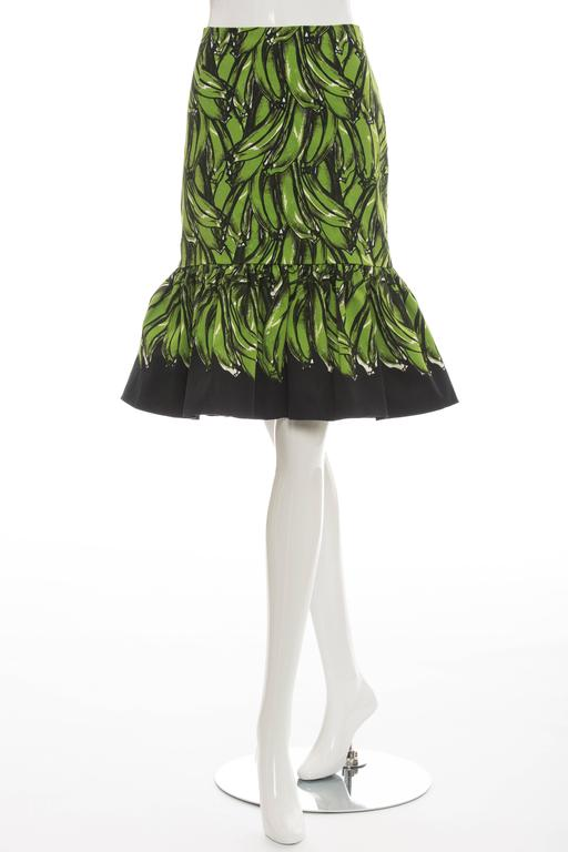 """Prada, Spring/Summer 2011 banana print skirt with flared hem and invisible zip closure at side seam.  Waist 29"""", Hip 35"""", Length 24.5"""" Fabric Content: 98% Cotton, 2% Other Fibers; Lining: 74% Cupro, 26% Silk"""
