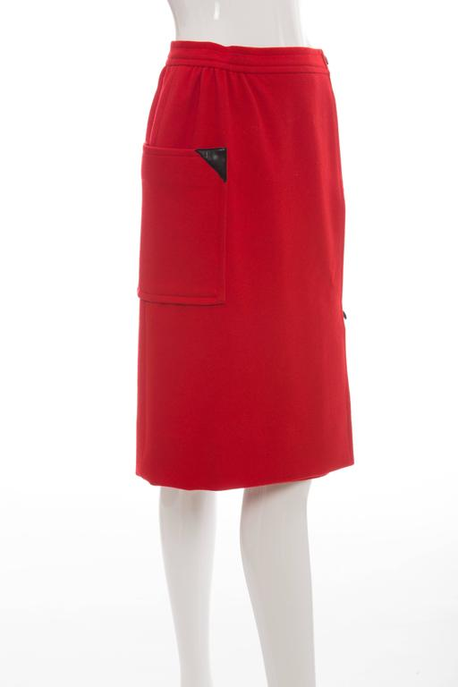 Courreges, circa 1970's red wool-cashmere, leather button front skirt with side pocket and fully lined.