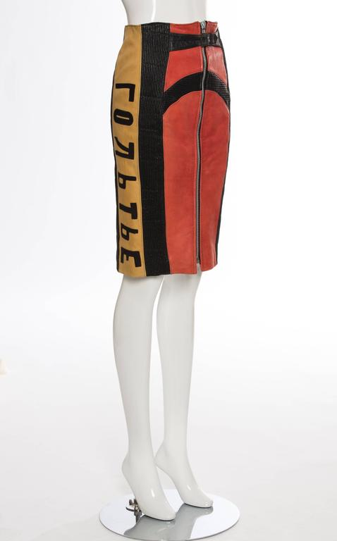 Jean Paul Gaultier, Autumn - Winter 1986 'Russian Constructivist' collection leather zip front skirt featuring smocked leather accents throughout, flocked cyrillic script panels at sides, belt accent at waist and fully lined.