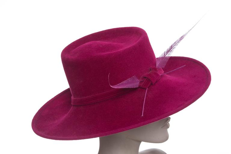 Philip Treacy wool felt side-swept dress hat with feather embellishments at  side. Includes 95c4130fa63d