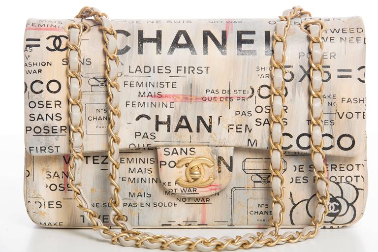 Chanel, Spring-Summer 2015, limited edition, newspaper print, lambskin, medium, graffiti logo, double flap bag with box, dustbag, care booklet, cleaning cloth.  Serial Number: 21045369  6.3' x 10'x 3' inches