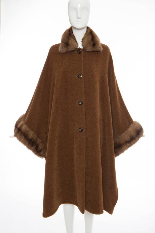 Revillon, late 20th Century, button front cinnamon alpaca cloak/cape with sable trim, side snap closures and one extra button.