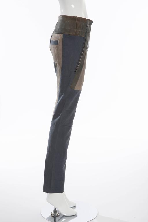 Balenciaga by Nicolas Ghesquière, Spring-Summer 2010, leather moto paneled pants with tonal stitching, elasticized waist, slit pockets at sides and dual exposed zip closure at front.   Size not listed, estimated from measurements.  Small Waist