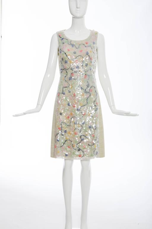 Chanel, Autumn-Winter 2001, wool sleeveless tweed dress featuring front clear paillettes and polychrome bead accents, back pleats, sash tie at back waist, concealed back zip closure and fully lined in silk.  FR.38 US. 6  66% Wool, 32% Nylon,